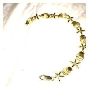 14 Kt. Yellow gold sea life bracelet EUC
